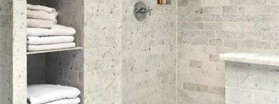 marble look tile shower and floor